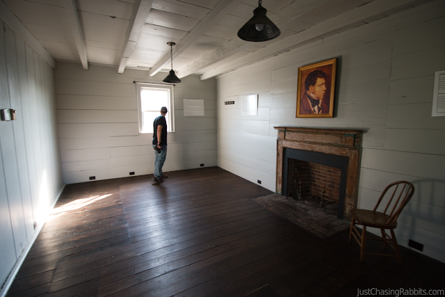 King's Tavern white room with fireplace and portrait in Natchez Mississippi