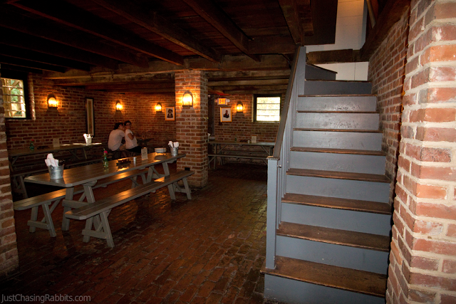 King's Tavern Natchez Mississippi Restaurant main seating area with staircase and brick walls