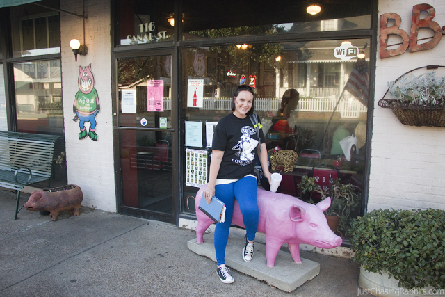 Photo op with a big pink pig at the Pig Out Inn barbecue restaurant in Natchez, Mississippi