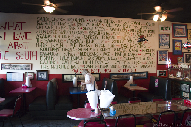 Interior of the Pig Out Inn barbecue restaurant in Natchez, Mississippi. The wall is a list of things to love about the South.