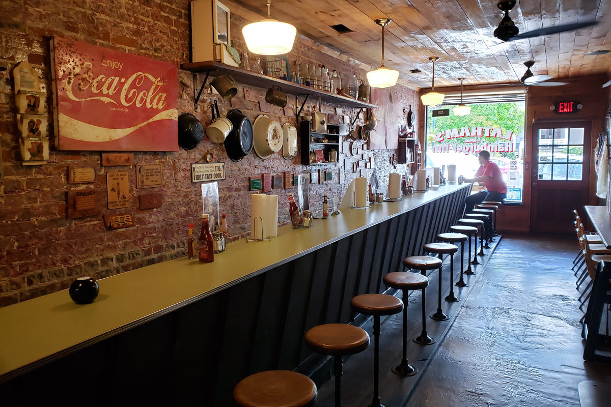 Interior of Latham's Hamburger Inn with counter and stools