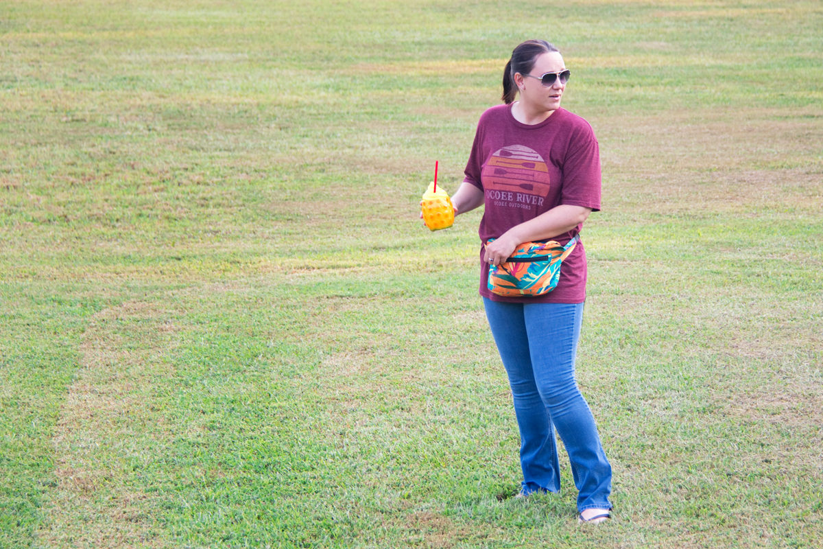 Wearing the Shinesty party poncho in fanny pack form