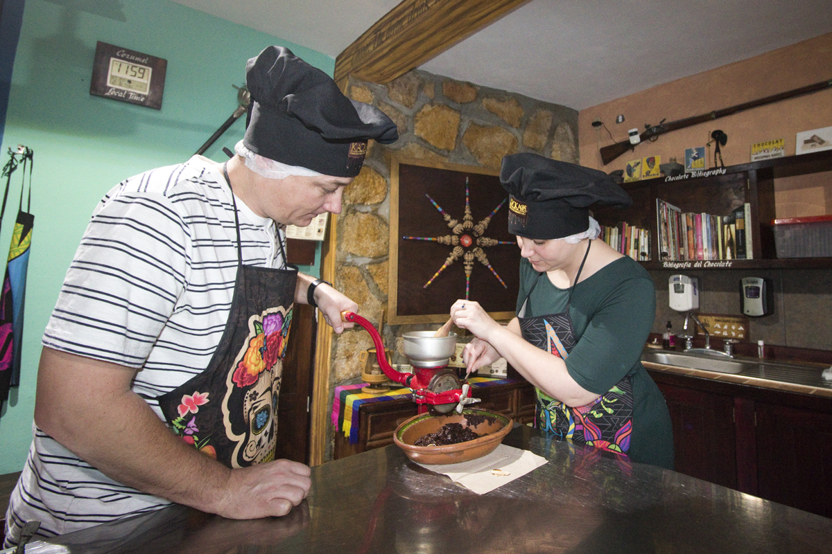 Grinding chocolate at Kaokao Chocolate Factory in Cozumel