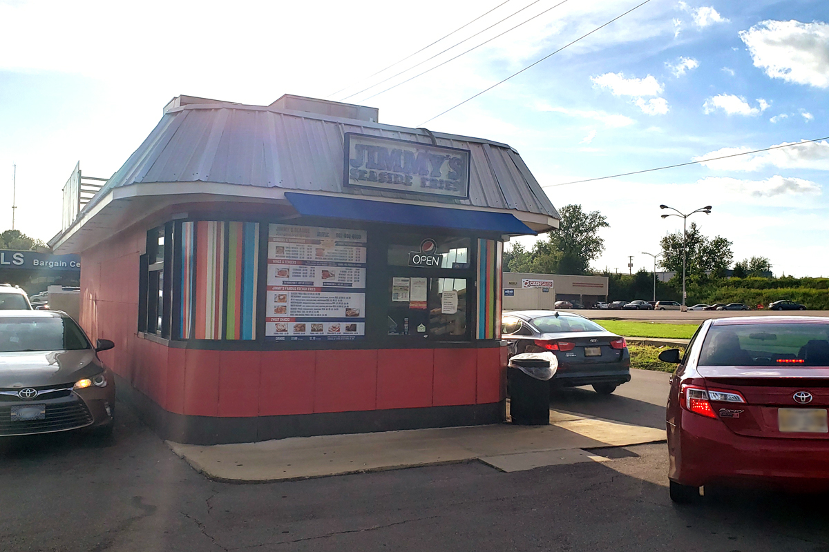 Exterior of Jimmy's Seaside Burgers and Wings with cars in the drive thru in Tupelo, Mississippi