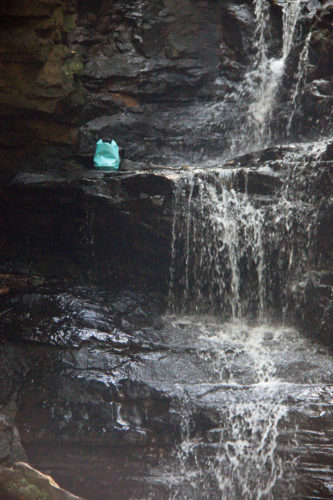 Outdoor Master Dry Bag sitting next to waterfall