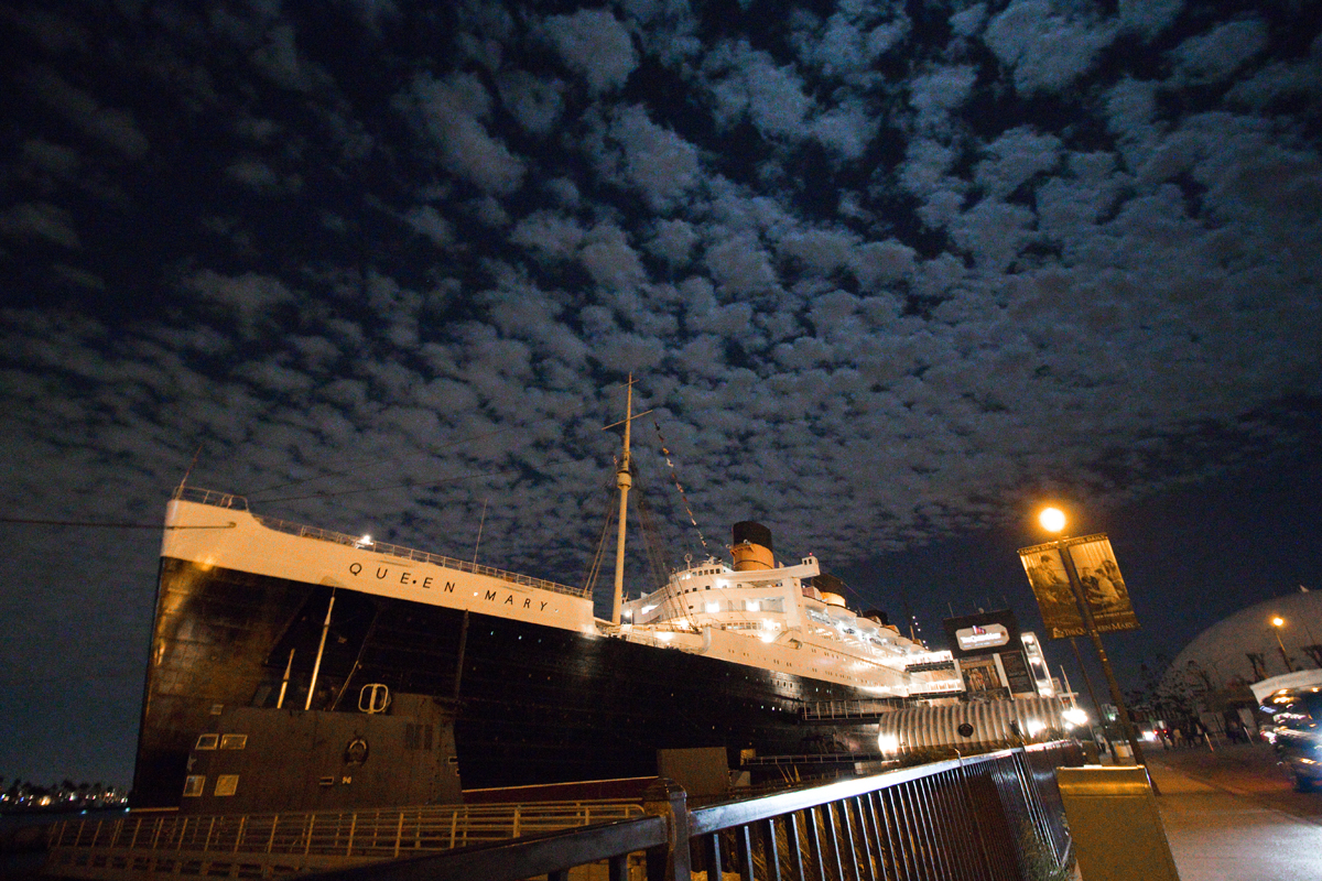 Queen Mary ship exterior with clouds in night time sky