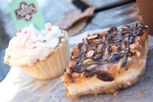 Cupcake and Sweet Treat from Sugaree's Bakery sitting on a picnic table