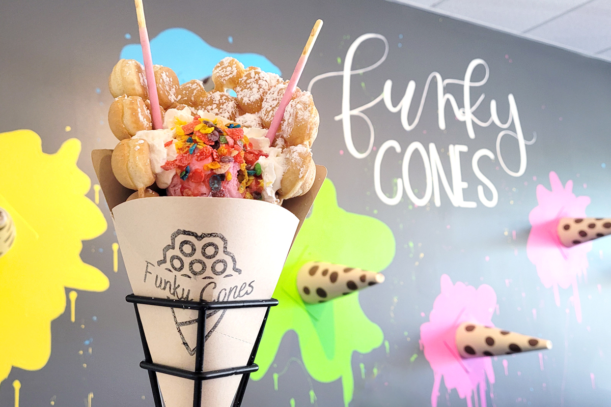 Berry Kiss bubble waffle Funky Cone in front of decorative wall