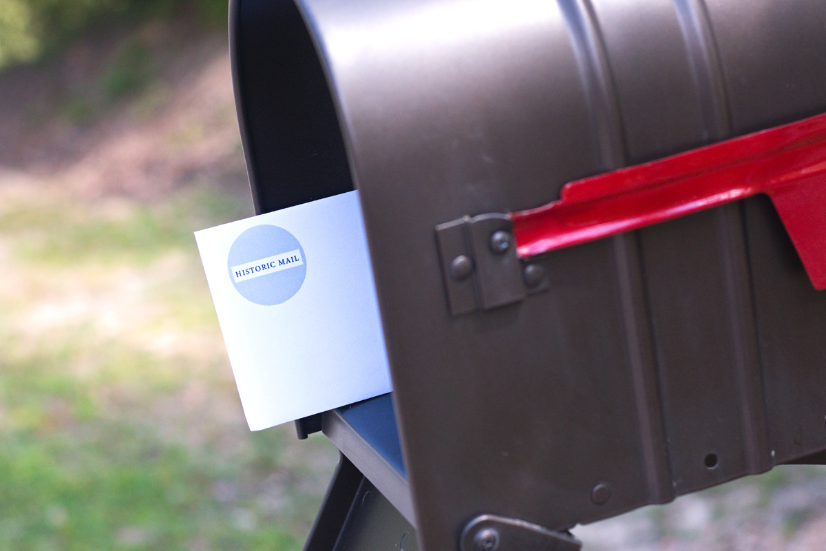 Historic Mail envelope sticking out of mailbox