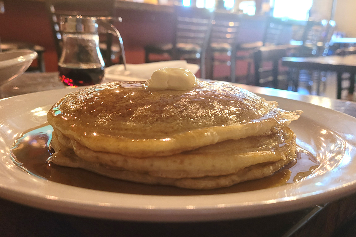 Pancakes with butter and syrup at D'Cracked Egg