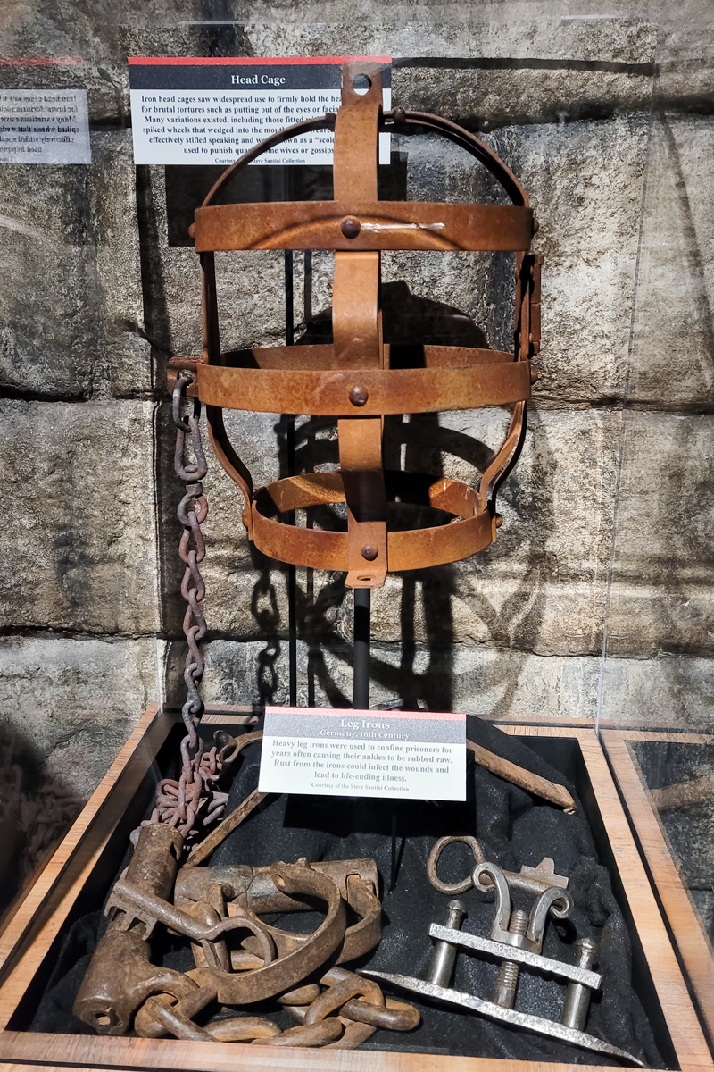 Head cage and leg irons torture devices on display at Alcatraz East