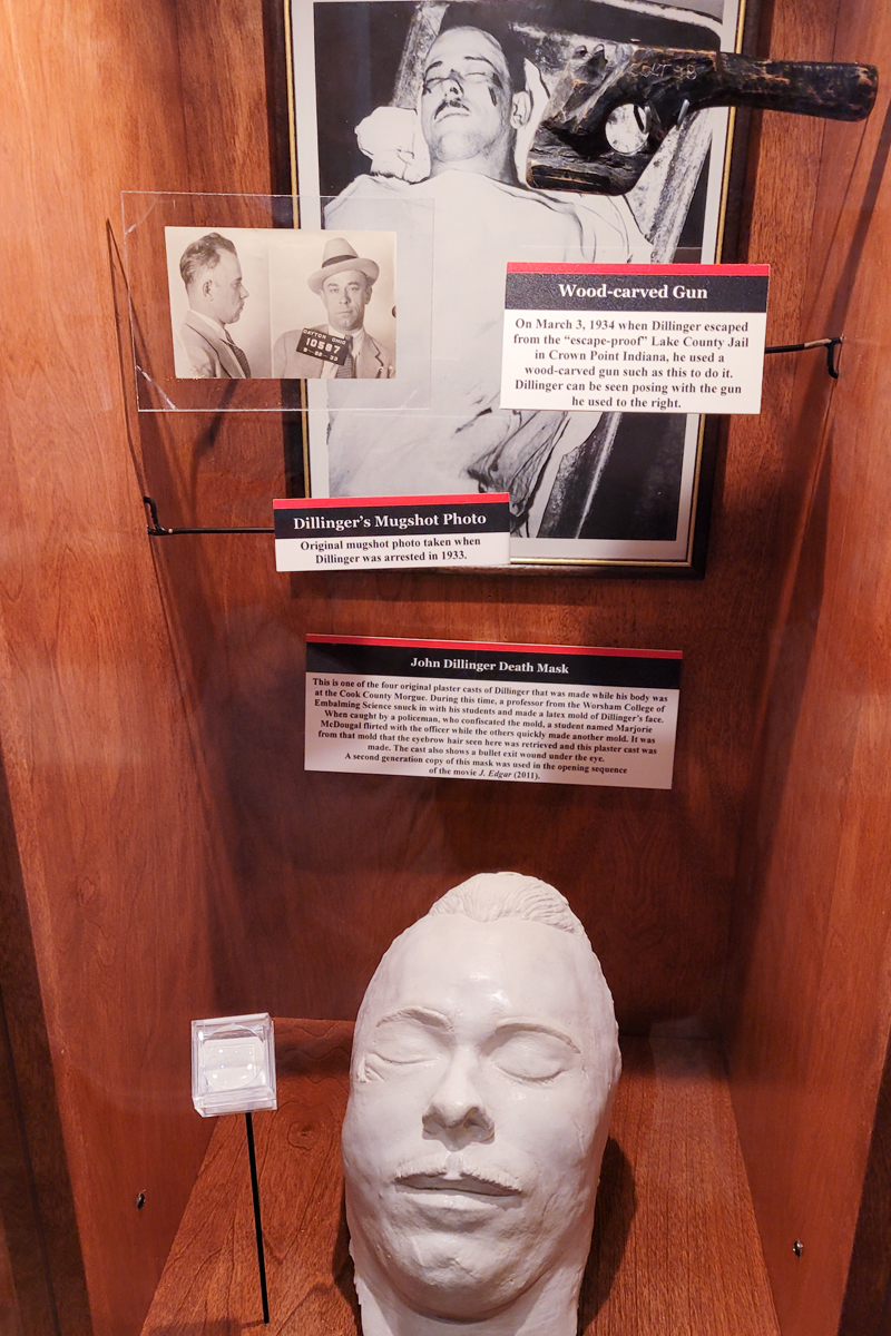 John Dillinger's wood-carved gun, death mask, and eyebrow hair on display at Alcatraz East